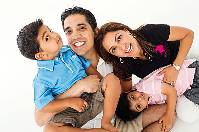 Family Dentists Dr. Ali and Dr. Shery Mansouri with their children